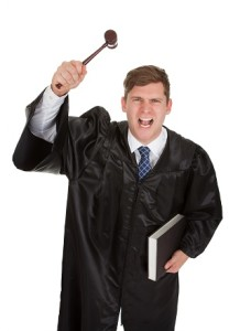Frustrated Male Judge With Gavel And Book